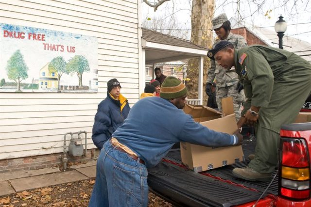 People offloading food at a shelter.